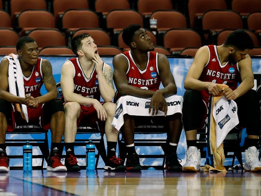 North Carolina State players watch from the bench during