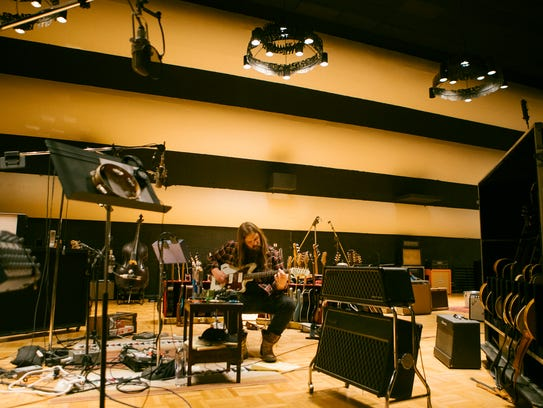 Chris Stapleton works on music in the recording studio.
