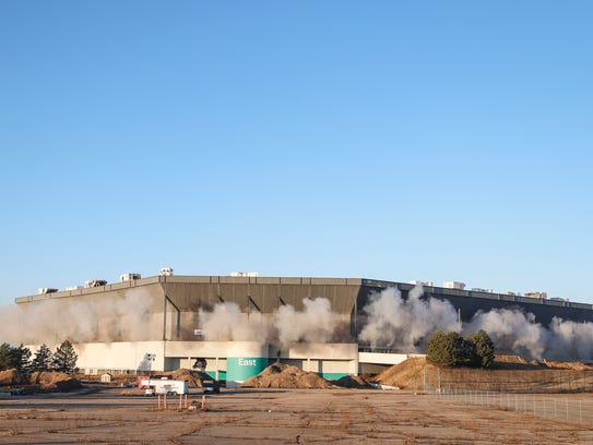 Smoke and dust come out of the Silverdome after a failed