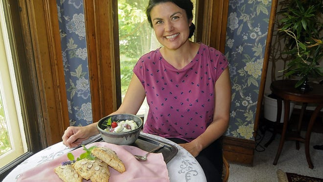 Jessica Eikelberry with her scones and strawberry cucumber salad.