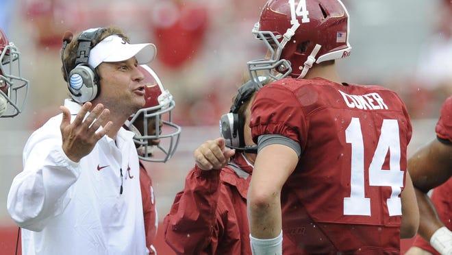 Alabama offensive coordinator Lane Kiffin talks to quarterback Jake Coker against Florida Atlantic last week.