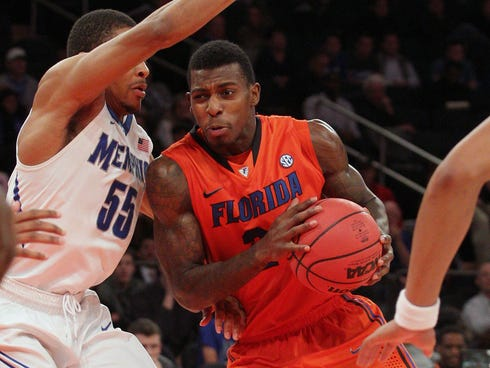 Florida forward Casey Prather (24) drives to the basket past Memphis guard Geron Johnson (55) during the second half of their game Tuesday night at Madison Square Garden. Florida won 77-75.