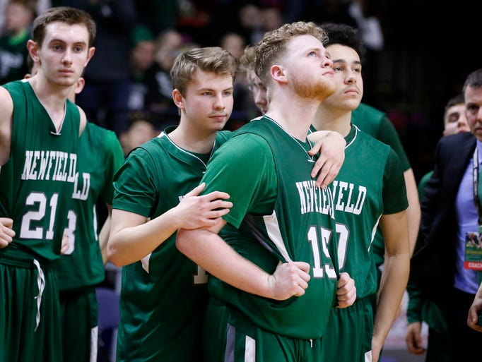An emotional Stephen LaBarge, a Newfield player, is