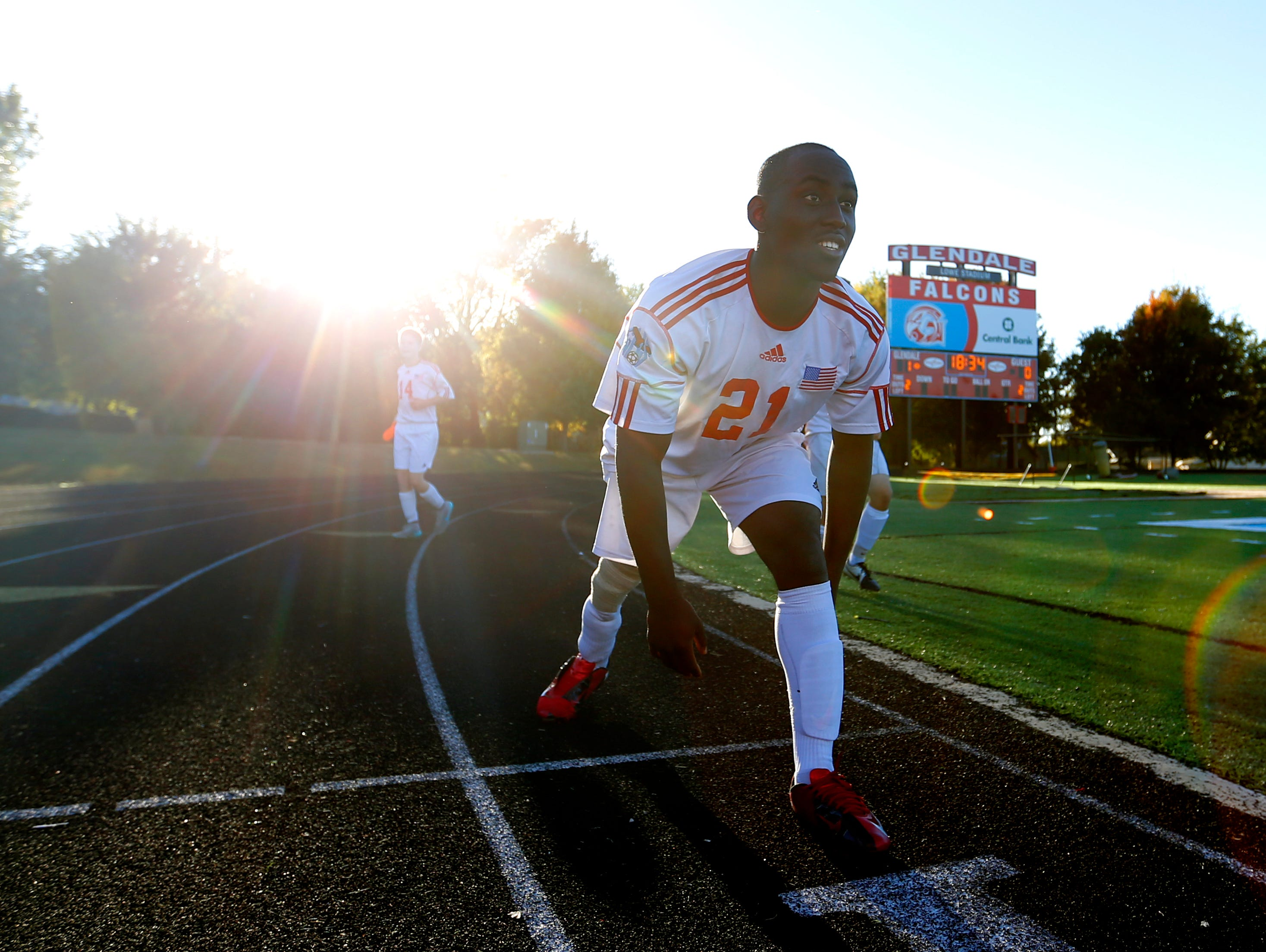 Glendale senior David Odun-Ayo stretches before entering a soccer game against Branson on Tuesday, Oct. 13, 2015. Odun-Ayo, who was born with proximal femoral focal deficiency, and is missing part of his right leg, runs and walks with a prosthetic leg is playing organized soccer for the first time.
