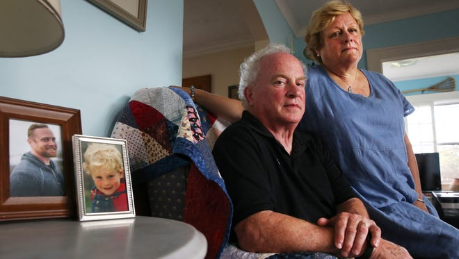Mary and Joe Mullin with photos of son Patrick Mullin,