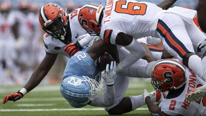 Syracuse players stop North Carolina's Dyami Brown at the goal line in the third quarter of Saturday's game in Chapel Hill, N.C. The Orange dropped their season opener 31-6 at No. 18 North Carolina.