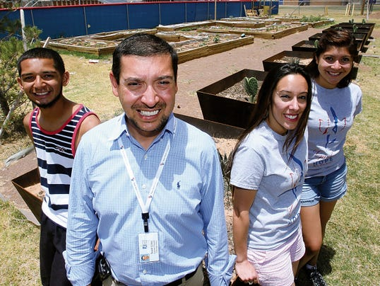 Irvin High School assistant principal Scott Gray, center, in the school's Garden of Hope with teacher Missy Saldaña, right, and students Giovanni Paz, left, and Berenice Acevedo, far right.