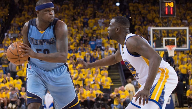 Memphis Grizzlies forward Zach Randolph controls the basketball against Golden State Warriors forward Draymond Green during the fourth quarter in game two of the second round of the NBA Playoffs at Oracle Arena.