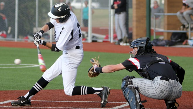 Rider's Rayce Radtke makes contact in Game 1 of the Region I-5A area series against Colleyville Heritage Thursday, May 11,2017, at Hoskins Field. The Panthers defeated the Raiders 3-0.