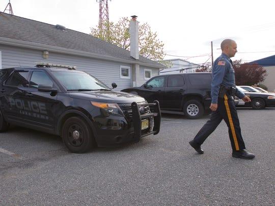Acting chief and Lt. Joe Oleszkiewicz walks away from
