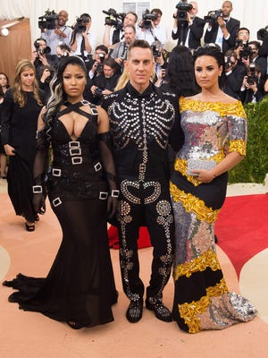 Nicki Minaj, left, Jeremy Scott and Demi Lovato arrive at The Metropolitan Museum of Art Costume Institute Benefit Gala, on May 2, 2016, in New York.