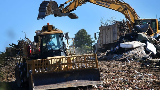 City waste disposal truck carrying tree limbs and yard waste are unloaded at the Memphis Wrecking Co landfill Thursday morning. After being rejected by a planning board, operators of the Frayser landfill have applied for a permit to expand their waste site near an elementary school.