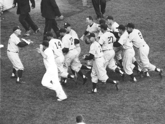 Yankees manager Casey Stengel greets his players after New York defeated the Milwaukee Braves, 6-2, in Game 7 of the 1958 World Series at County Stadium.