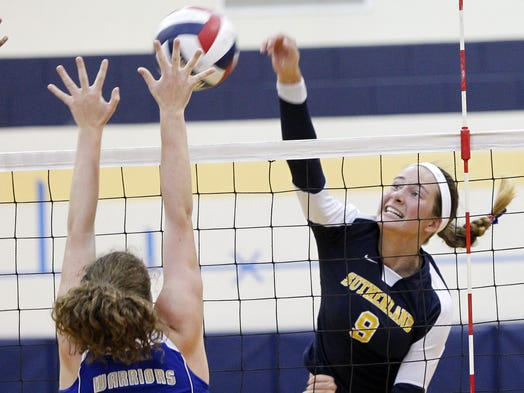 Pittsford Sutherland's Luisa Schirmer, right, sends a kill past Webster Schroeder's Katie McKrell during girls volleyball action between the Knights and the Warriors in Pittsford on Wednesday, Sept. 11, 2013. Sutherland won in four games.
