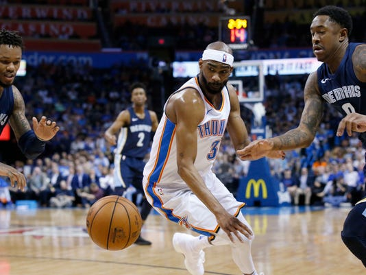 Memphis Grizzlies guard Ben McLemore, left, Oklahoma City Thunder forward Corey Brewer (3) and Memphis guard MarShon Brooks, right, chase the ball during the first half of an NBA basketball game in Oklahoma City, Wednesday, April 11, 2018. (AP Photo/Sue Ogrocki)
