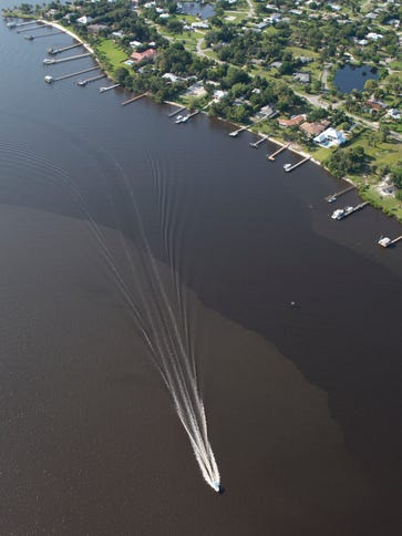 Polluted water from Lake Okeechobee discharges are
