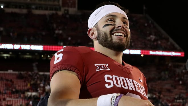 Oklahoma Sooners quarterback Baker Mayfield (6) celebrates with fans after the game against the Texas Tech Red Raiders at Gaylord Family - Oklahoma Memorial Stadium.