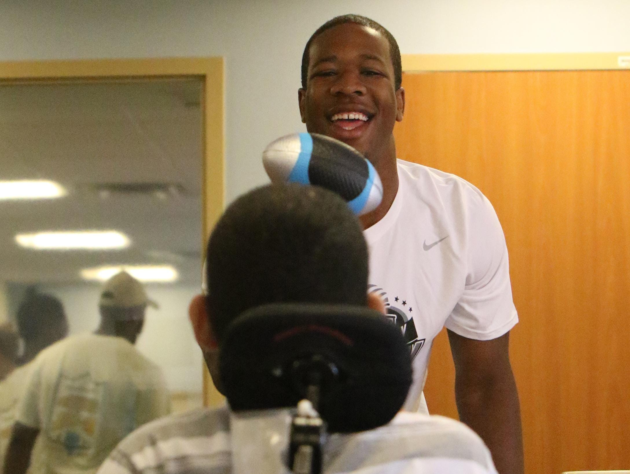 Jaquan McLeod of Roselle High School interacts with a patient at Children's Specialized Hospital in Mountainside on Monday as the Snapple Bowl's Union County All-Stars made their annual visit.