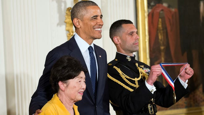 President Barack Obama on stage with Dr. Nancy Ho, from Green Tech America, Inc. and Purdue University, as he awards her the National Medal of Technology and Innovation, May 19, 2016, during a ceremony in the East Room of the White House in Washington.