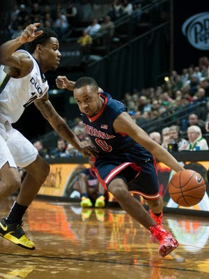 Jan 8, 2015; Eugene, OR, USA; Arizona Wildcats guard Parker Jackson-Cartwright (0) gets past Oregon Ducks guard Ahmaad Rorie (14) during the first half of the game at Matthew Knight Arena.