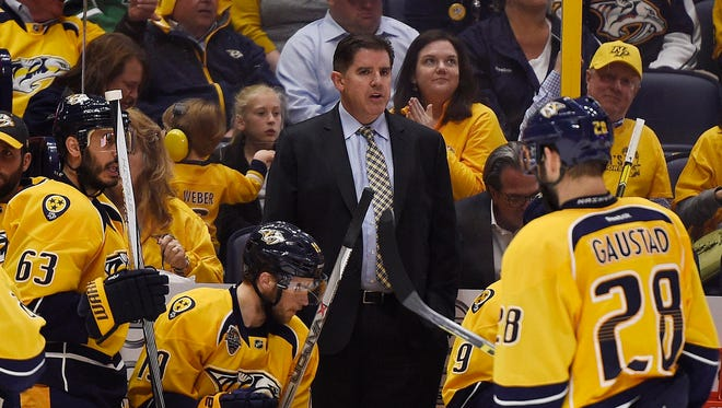 Nashville coach Peter Laviolette looks on from the bench in the second period of Game 6 between the Predators and the Sharks at Bridgestone Arena Monday May 9, 2016, in Nashville, Tenn.