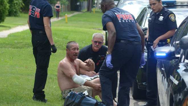 A Battle Creek man is treated after a fight and shooting Wednesday.