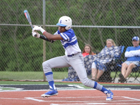 Salem's Carlton Harper hits the baseball in a 6-5 loss