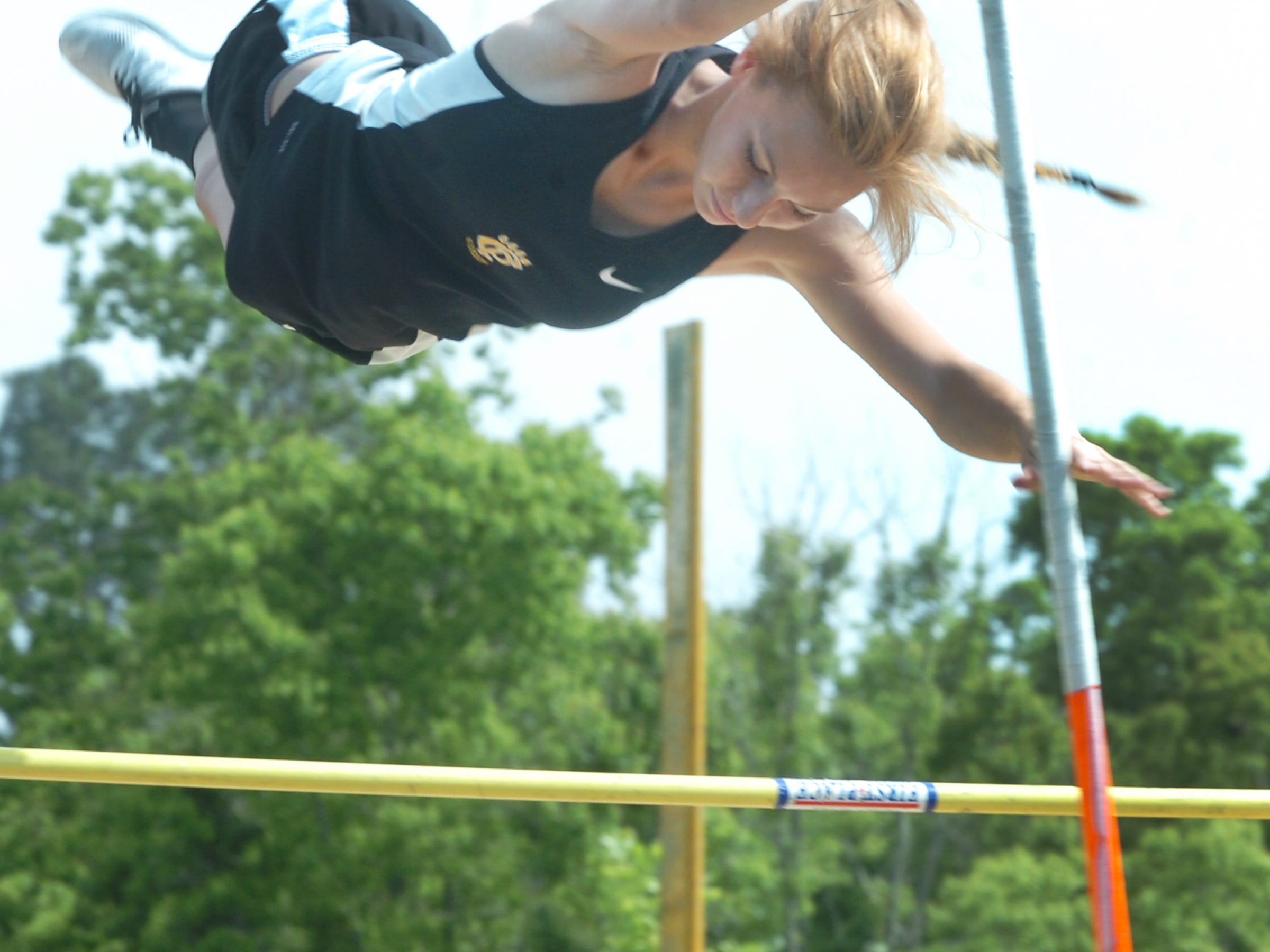 Church Point pole vaulter Lauren Sonnier attempts to clear the bar Wednesday during the District 5-3A track meet at Church Point High. Sonnier won the event at nine feet, six inches. Sonnier also won the 300-meters hurdles.