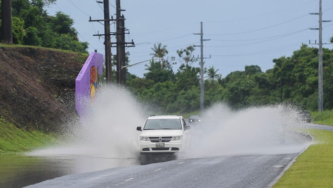 This Sept. 8, 2017, file photo shows a vehicle passing through a flooded outer lane on Marine Corps Drive in Sumay. There's a flood advisory for most of southern Guam until 9:30 p.m. Sept. 13.