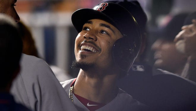 Boston Red Sox's Mookie Betts smiles in the dugout after hitting a solo home run off Philadelphia Phillies' Adam Morgan during the ninth inning on June 14, 2017.