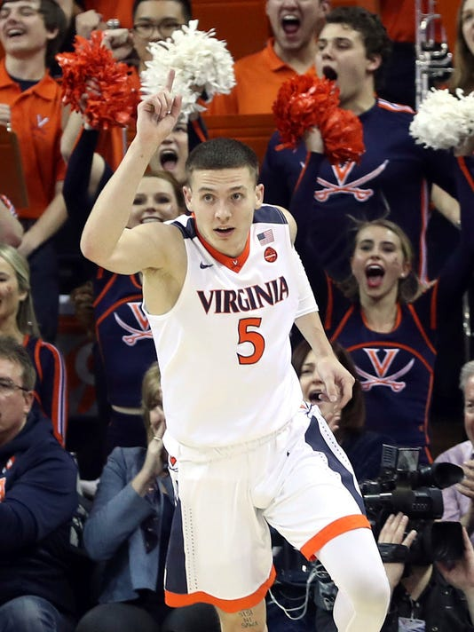 Virginia guard Kyle Guy (5) reacts to making a basket during an NCAA college basketball game against Louisville, Wednesday, Jan. 31, 2018, in Charlottesville, Va. (AP Photo/Andrew Shurtleff)