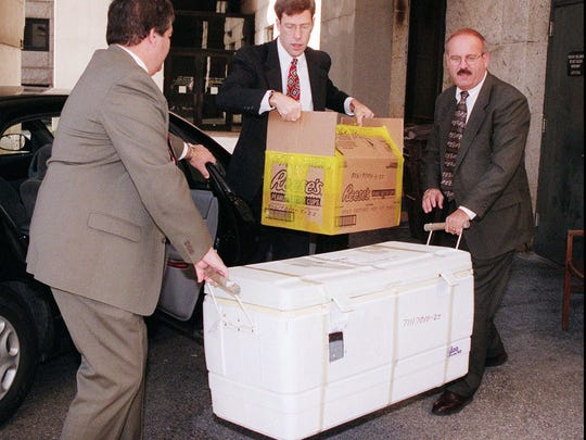 FBI detectives carry evidence for the Thomas Capano murder trial into the courthouse in Wilmington, Del., Wednesday, Dec. 2, 1998.