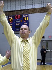 Don Dimoff celebrates his team's 42-41 win over Delone Catholic in 2004.
