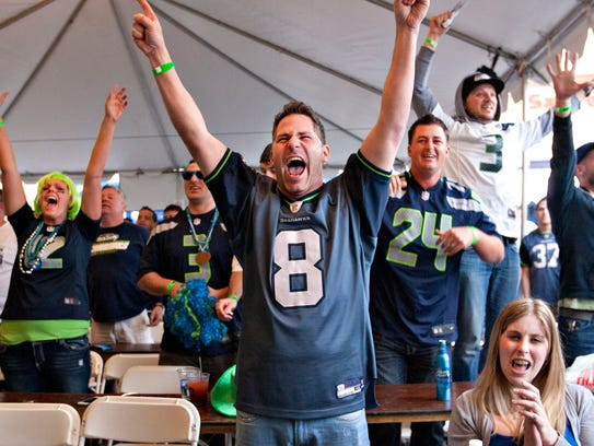Fans cheer after the Seahawks complete a touchdown