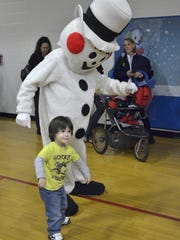 Jackson Roberts dances up a storm with Frosty. Jackson is 2 1/2 years old. Mom Michele Roberts, says that he loves to dance.