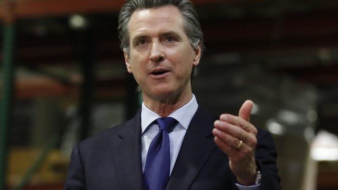 Gov. Gavin Newsom gestures during an update June 26, 2020, in Rancho Cordova, Calif., on the coronavirus pandemic. Newsom said Monday, July 27, 2020, the state will spend $52 million to tackle the outbreak in eight Central Valley counties. He said the money will go toward helping improving isolation, quarantine, and testing policies and to helping health care workers.