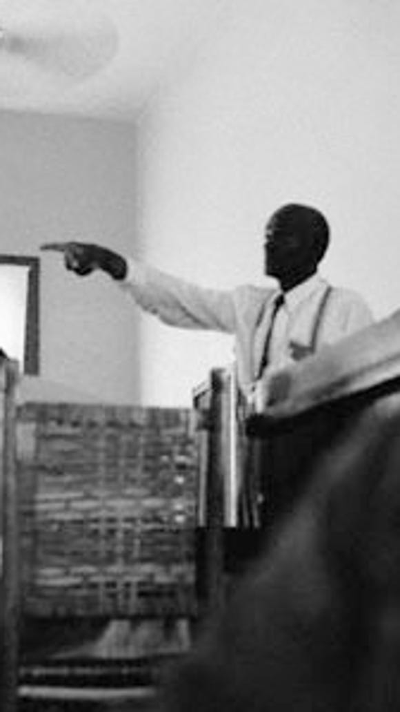 Mose Wright, Emmett Till's great-uncle, took the witness stand and identified J.W. Milam as one of his nephew's abductors. Ernest Withers took the photograph for The Chicago Defender.