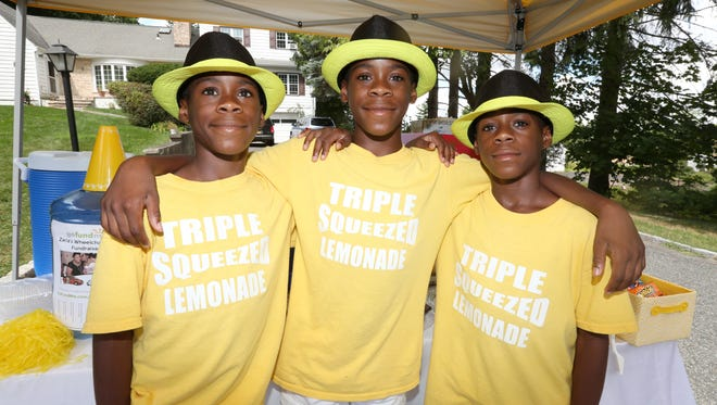 Triplets Cameron, left, Brandon and Jordan Shorte, 12, ran the Triple Squeezed Lemonade stand in front of their Spring Valley home.