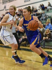 Mariemont's Ashley Rothert drives past a Carroll defender.