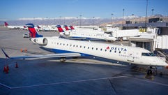 Delta Air Lines regional jets are seen at Salt Lake