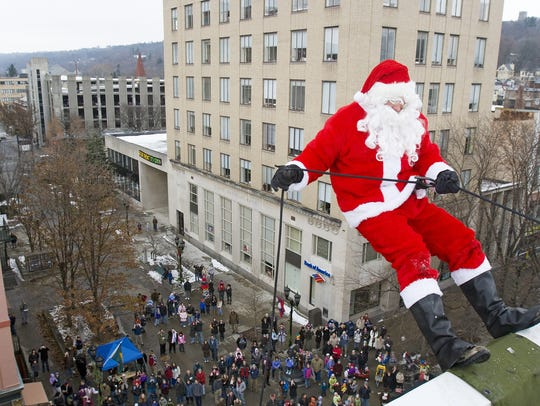Dressed as Santa Claus, the Ithaca Police every year