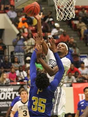 Mariner forward Jahmel Myers goes up over Palatka's Mitchell McKinnon during the FHSAA 6A state semifinal Thursday in Lakeland.
