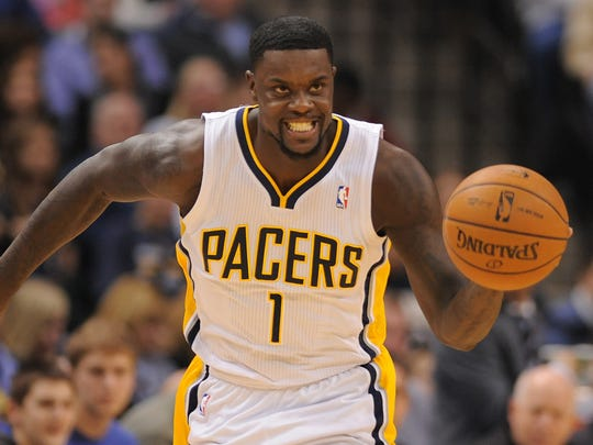 Indiana Pacers guard Lance Stephenson brings the ball up court after grabbing a rebound against the Washington Wizards inside Bankers Life Fieldhouse, January 10, 2014, in Indianapolis.