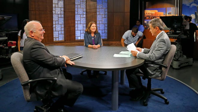 1st Congressional District candidates Republican Andy Tobin , left and Democrat Ann Kirkpatrick, center  take part in a debate moderated by Ted Simons, right,  at the Eight, Arizona PBS studios Wednesday, Sept. 24,  2014 in Phoenix, Ariz
