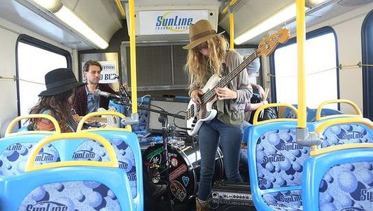 Gene Evaro Jr & The Family perform on the first Sound Bus route from Palm Springs during the Mobile Music Festival Saturday, November 1, 2014. SunLine riders were treated to live music on certain routes.