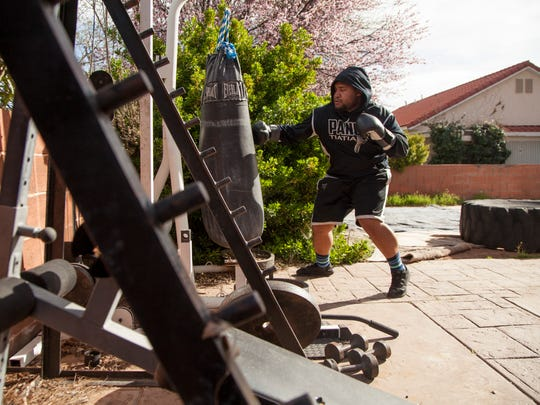 Local boxer Pano Tiatia trains at his home gym in preparation
