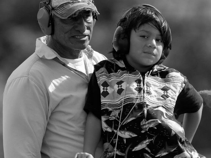 Miccosukee tribal members, Bobby Tigertail and his grandson, Jonovan Tigertail, 7, were taking visitors  to Miccosukee Indian Day on Airboat rides at the tribal resort and casino.