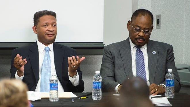 Artur Davis speaks as Dan Harris takes notes during a Mayoral debate on Thursday, July 30, 2015, at Faulkner University in Montgomery, Ala.