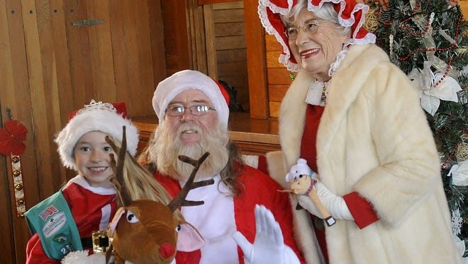 Alina Williams, 9, has her photo taken with Santa and Mrs. Claus during Fernley's 2017 Christmas festivities.