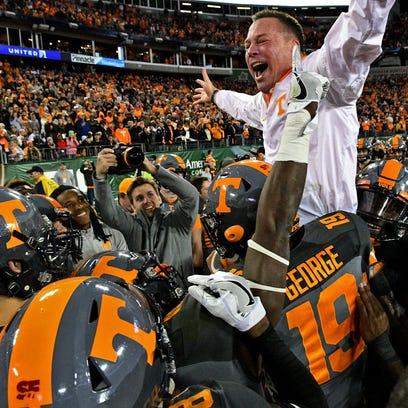 Tennessee Volunteers head coach Butch Jones celebrates